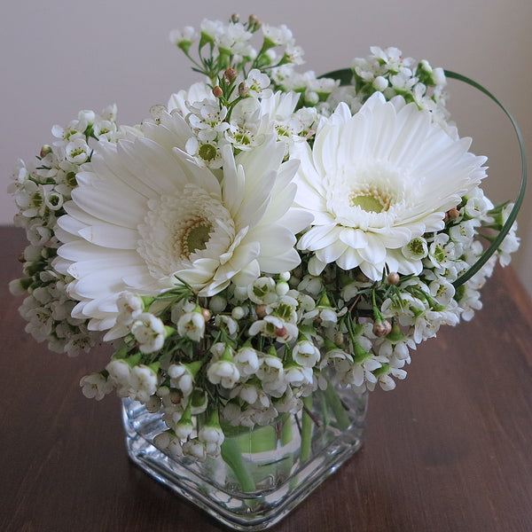 Flowers used: white gerberas, white wax flowers