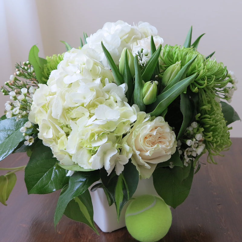 Flowers used: white roses, green chrysanthemums, white tulips, white wax flowers