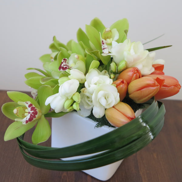 Flowers used: white freesias, red tulips, chartreuse cymbidium orchids