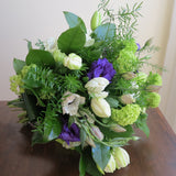 Flowers used: white tulips, green viburnums, white anemones, purple lisianthus