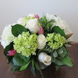 Flowers used: cream roses, white and green hydrangeas, pink tulips, chartreuse lisianthus