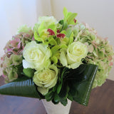 Flowers used: green roses, rusty green hydrangeas, chartreuse cymbidium orchids