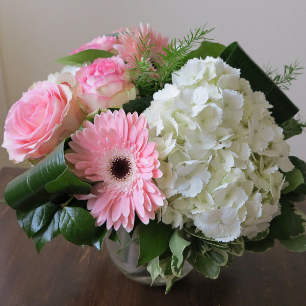 Flowers used: blush pink roses, pink gerberas and white hydrangeas