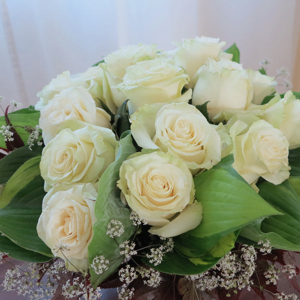 Flowers used: cream roses, hosta leaves