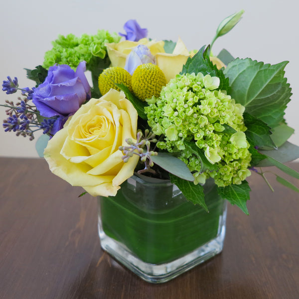 Flowers used: yellow roses, purple lisianthus, green hydrangeas