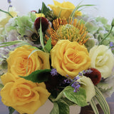 Flowers used: yellow roses, cream lisianthus, blue lavender, orange protea and rusty hydrangeas