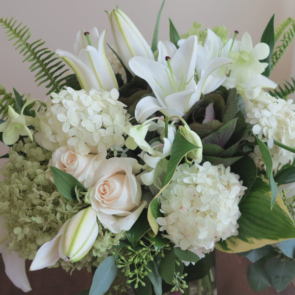 Flowers used: cream roses, white and green hydrangeas, white orchids, white lilies, green kales
