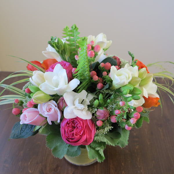 Flowers used: pink roses, orange ranunculus, white freesias, white Anne's Lace, pink hypericum berries