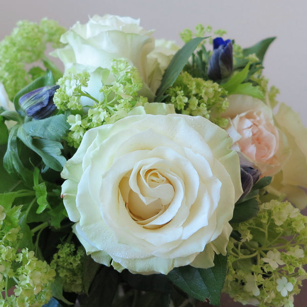 Flowers used: white and pink roses, green viburnums, blue anemones