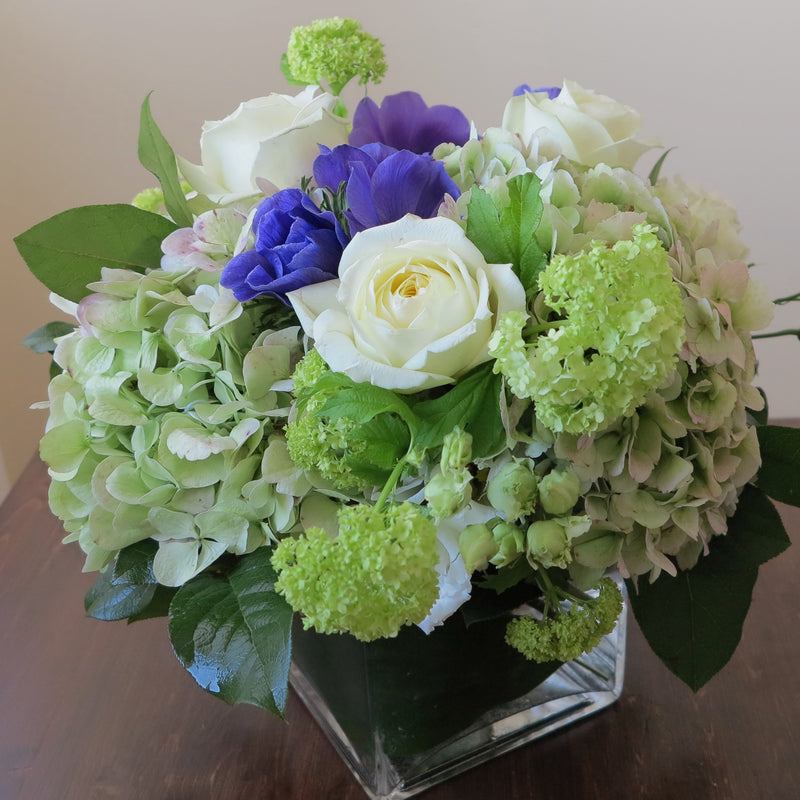 Flowers used: cream white roses, blue anemones, green hydrangeas, green viburnum, white lisianthus