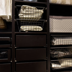 A beautifully organized closet with drawers and shelves.