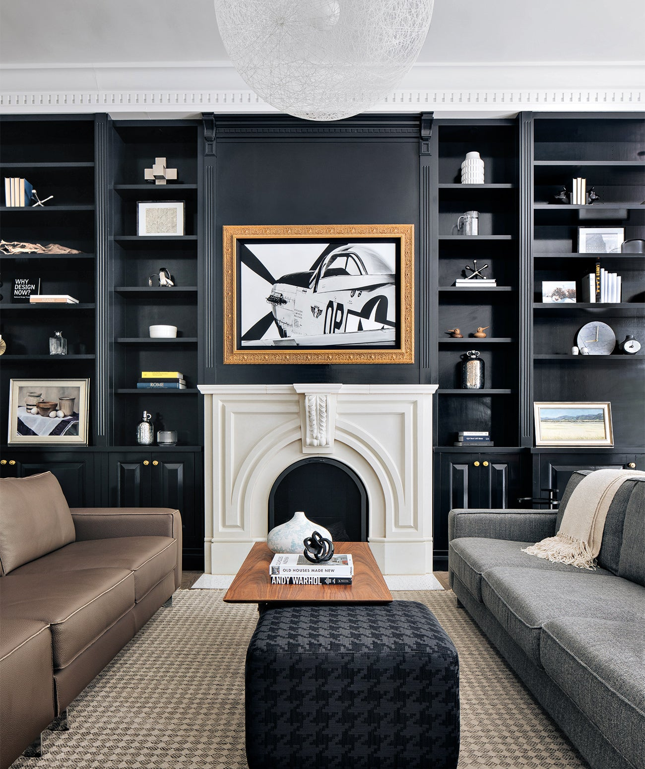 A dark wall with traditional white fireplace/Photography: Stoffer Photography Interiors/Benjamin Moore's Twilight Zone paint provides a striking backdrop for the traditional fireplace in this Chicago home designed by Abbie Anderson Design.