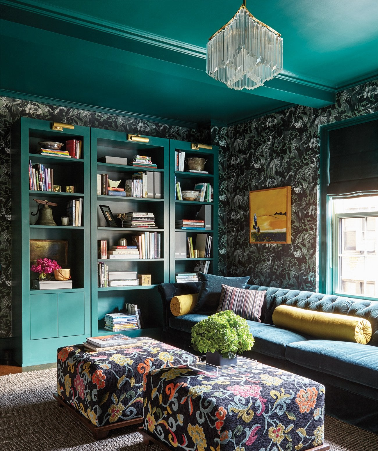 A deep aqua-painted library/Photography: Joshua McHugh/With millwork painted in Sherwin-Williams's Country Squire, and wallpaper from House of Hackney, this gem-toned library was designed for a New York City home by BarlisWedlick Architects LLC.
