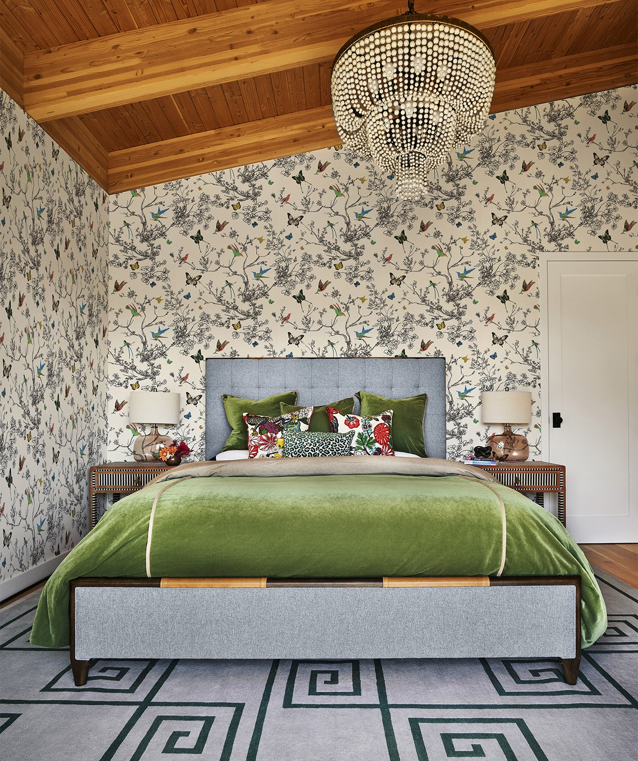 """A bedroom with floral wallpaper/Photography: Blackstone Edge/""""Wallpaper is a different universe than paint. It offers an instant mood. I use it liberally and highly recommend it,"""" says Angela."""