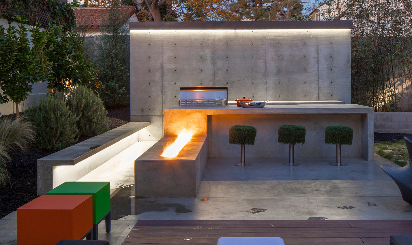 A patio with colorful accents/Photography: Art Gray/A heated outdoor patio and fireplace provides indoor/outdoor living space.