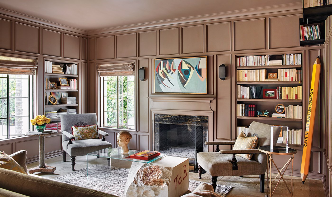 A light brown library/Photography: Trevor Tondro/A custom Farrow & Ball paint color appears on the walls of this library in a Beverly Hills home designed by Andrea Michaelson Design.