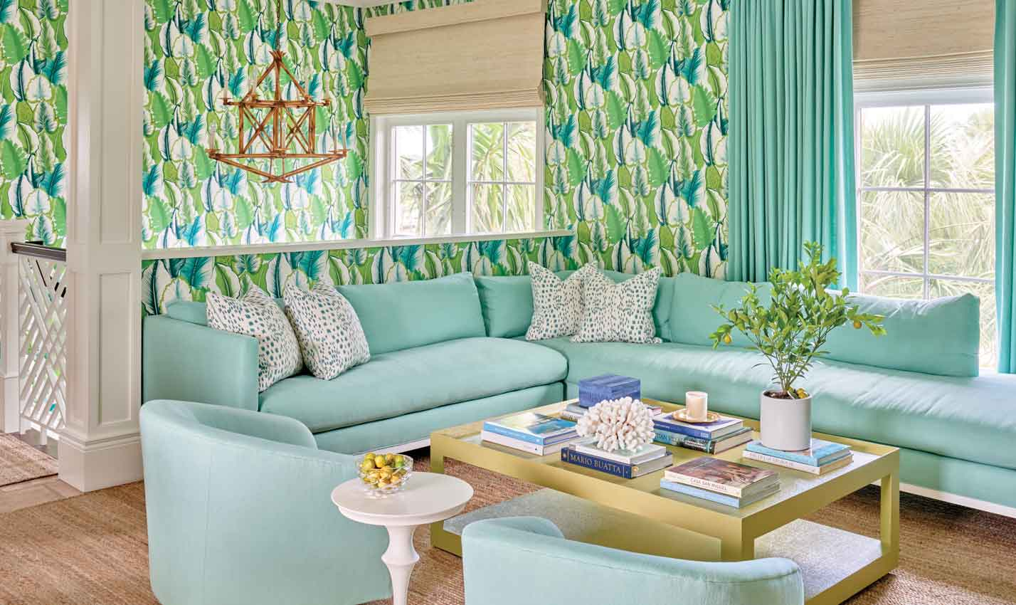A tropical living room with green and blue printed wallpaper/Photography: J. Savage Gibson/Why stop at paint? This living space by designer Meg Braff features Manuel Canovas' Malfa wallpaper with a cheerful green and blue leaf motif.