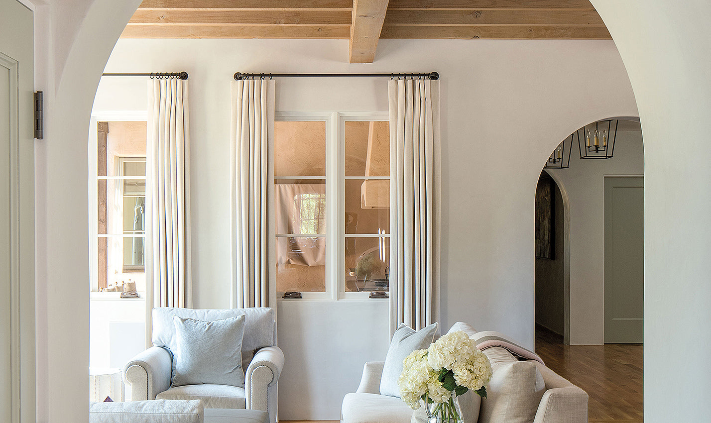 A neutral hued family room/Photographer: Joshua Wells/A family room in an Arizona home, designed by Dana Lyon of The Refined Group Architecture and Gene Kniaz of Spiral Architects, is bathed in neutrals.