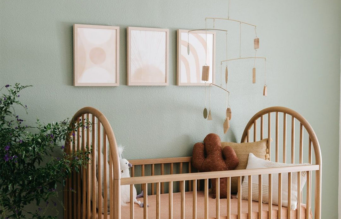 Pale green nursery wall with crib/Photography: Rennai Hoefer/While this pale green space by Lexi Grace Design veers modern, not traditional, the gentle neutrals and simple crib design would work in a variety of spaces, both small and large.
