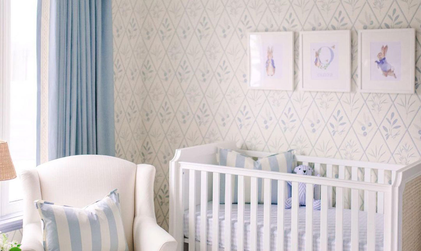 A pale blue nursery with patterned white and blue wallpaper/Courtesy of Clary Bosbyshell/Another soothing space by Atlanta-based designer Clary Bosbyshell harnesses the gentle strength of pale blue hues.