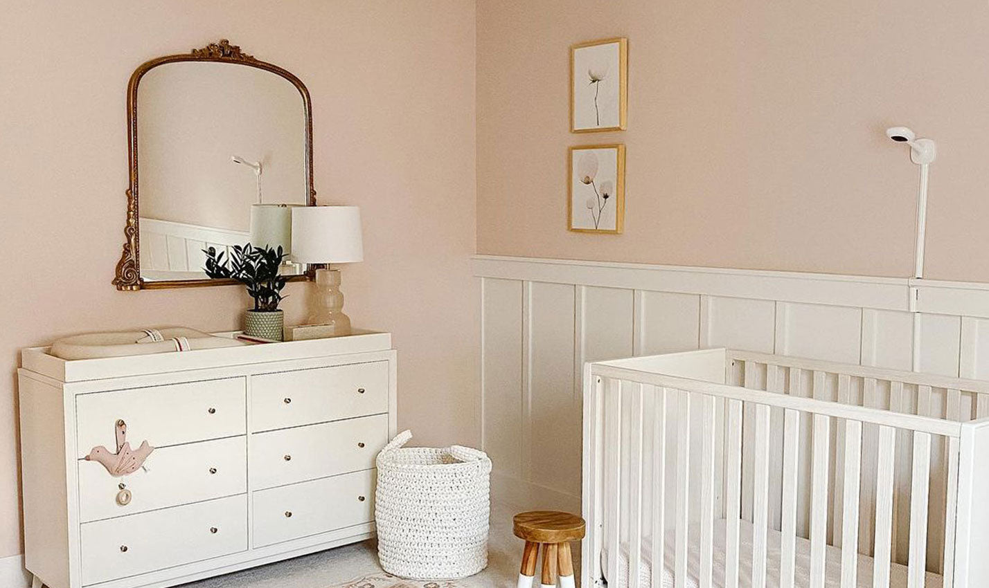 A pale pink nursery/Photography: Elle Young Design/Ohio designer Elle Young dreamt up this pretty-in-pink baby's room.
