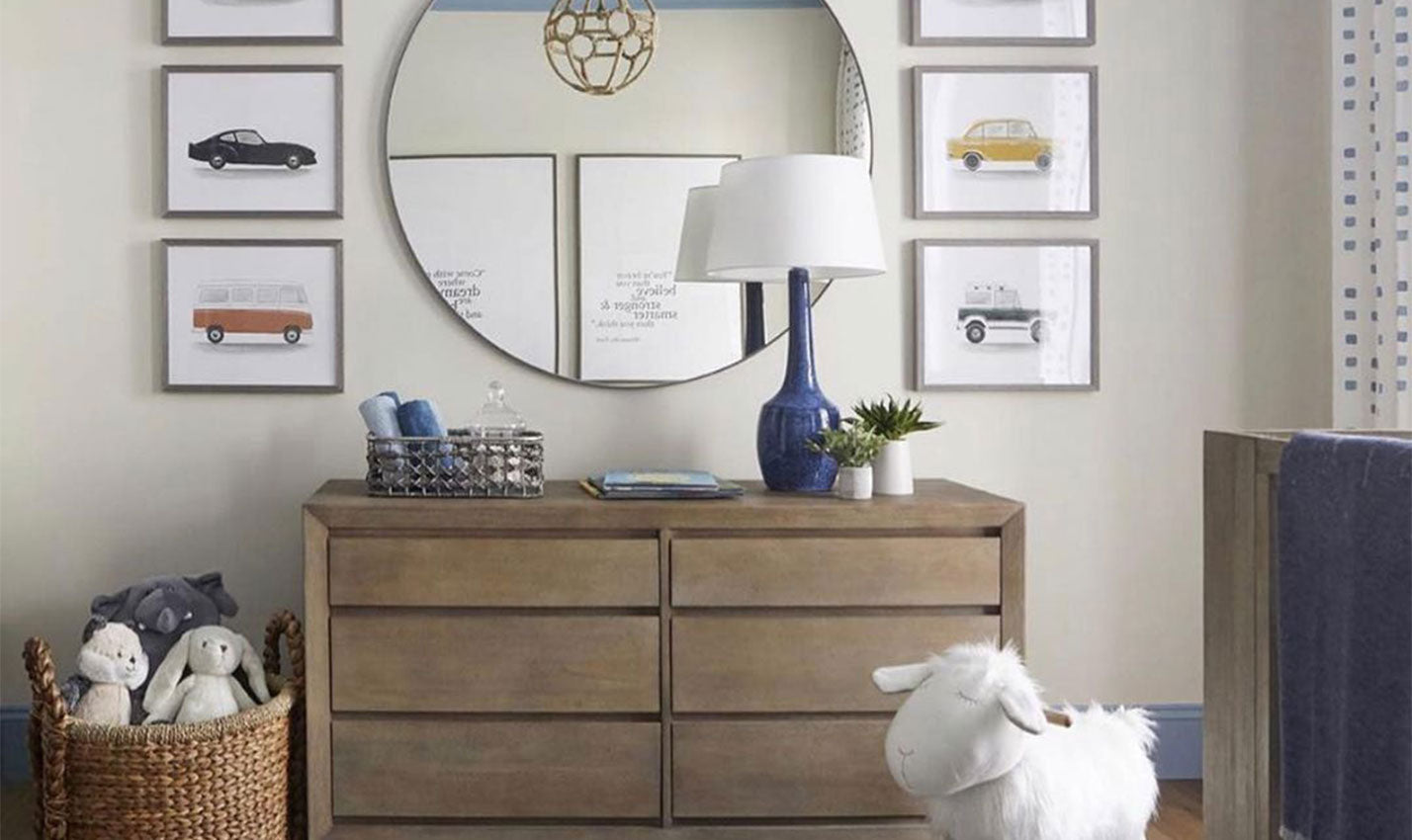 A pale wall with mirror and framed prints/Photography: Curtis Elmy/Designed by Atmosphere Interior Design, this simple space for the future car love features loads of printed artwork