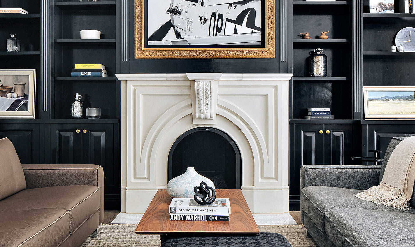 A deeply hued living room featuring a fireplace/Photographer: Stoffer Photography Interiors/ Benjamin Moore's Twilight Zone paint highlights enviable crown molding in this sitting room designed by Abbie Anderson Design.