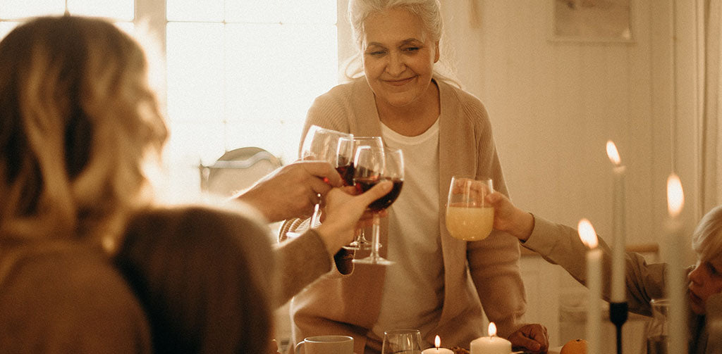Family having meal at home cheering with wine glasses
