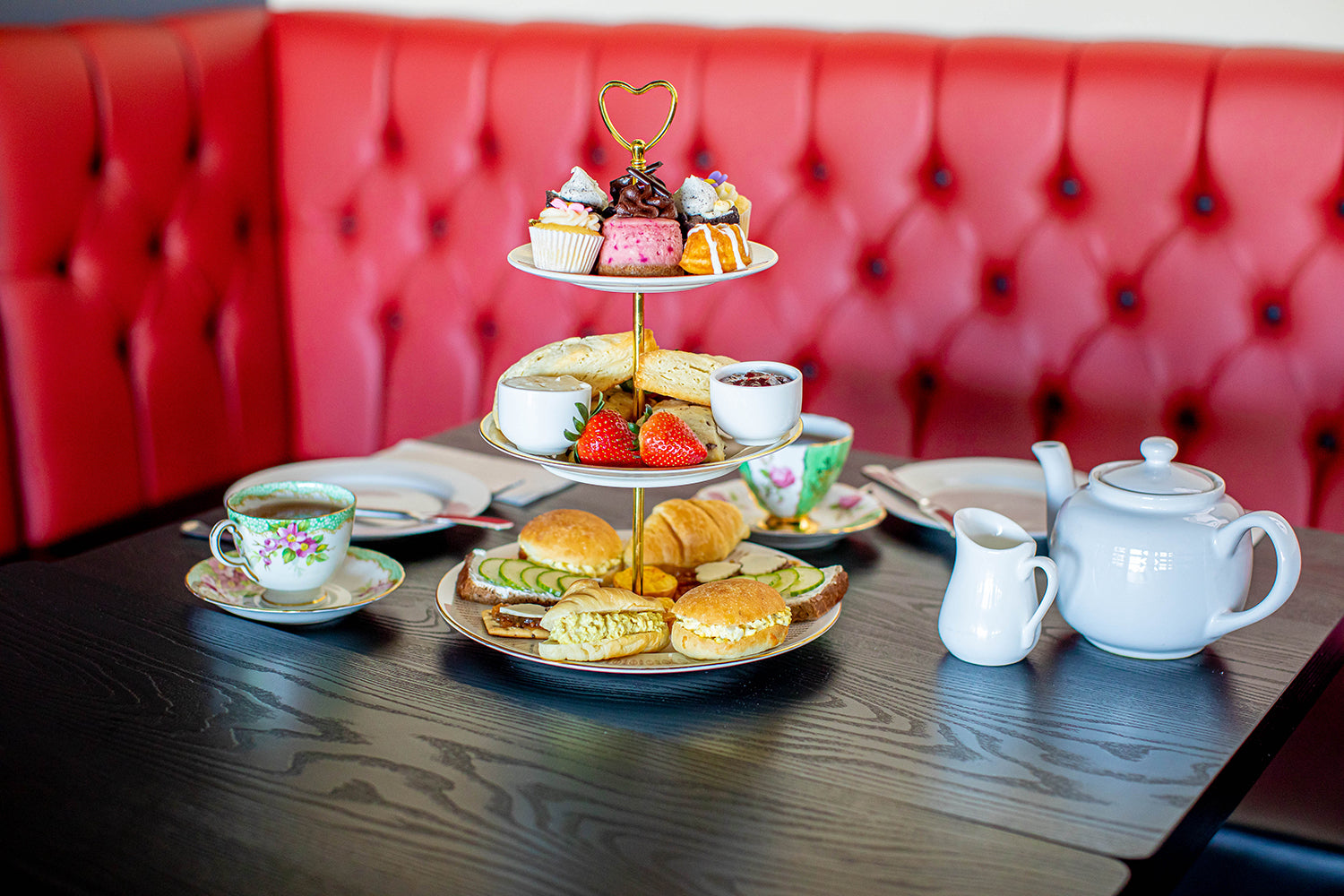 Afternoon Tea in front of the red bench Queen of Hearts Tea House Kitchener Ontario