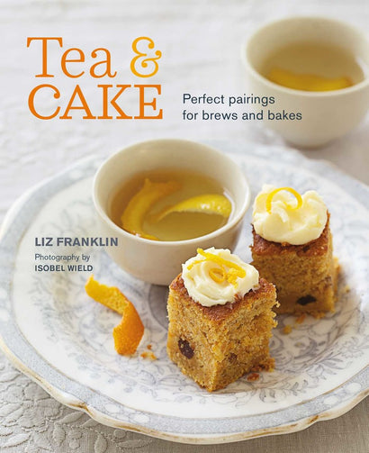 A hard cover coffee table recipe book with nice photos and yummy food from from Queen of Hearts Tea House Kitchener.