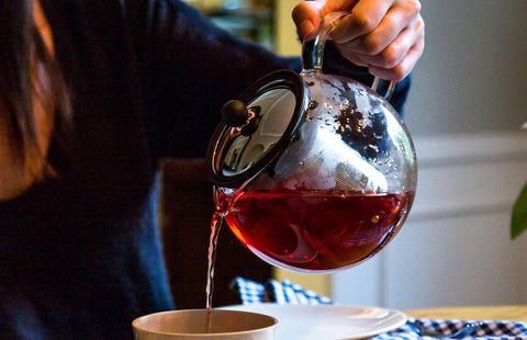 pouring fresh brewed tea