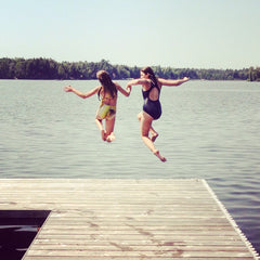 two girls jumping in the water