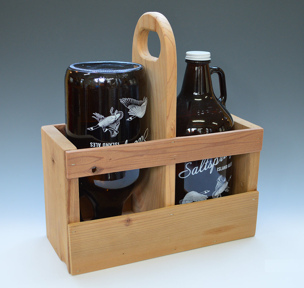 Growler Carrier made from local and/or reclaimed woods and finished with 100% hemp oil. Fits two standard size growlers. Drain holies in each side.