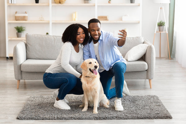 Couple taking a selfie with their dog