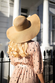 Oversized floppy hat in natural straw