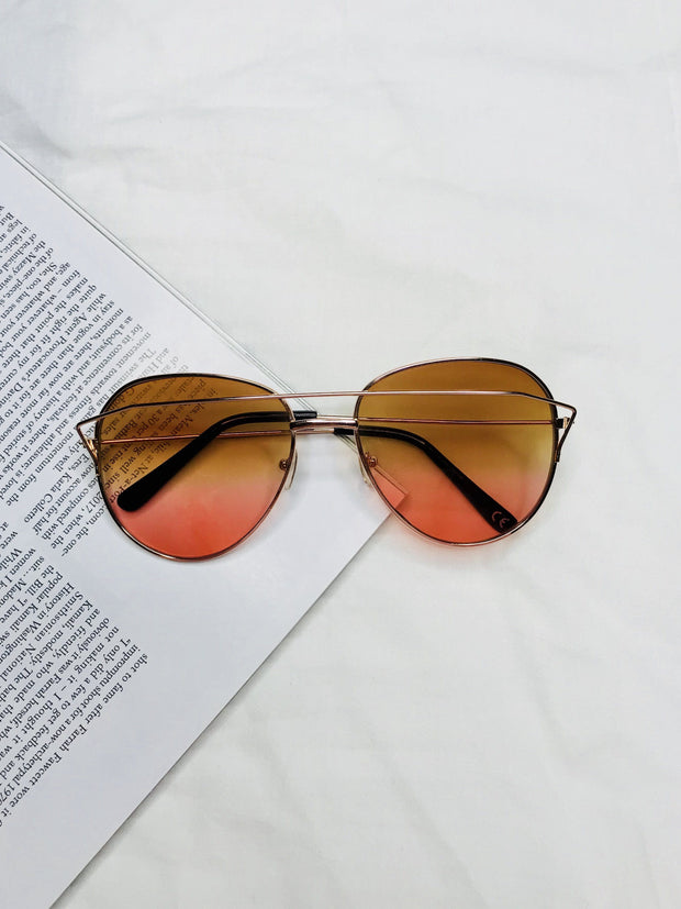 Gold round sunglasses with pink lens