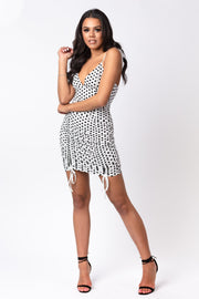 White polka dot ruched mini dress