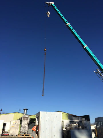 Frank's Sausages lifting the new smokehouse by crane into our new Paeroa premise
