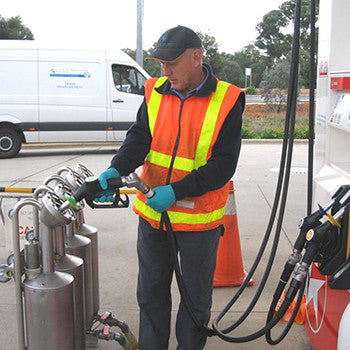 man using a fuel dispenser