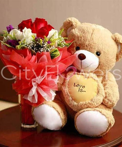 A LOVING TEDDY WITH BLOOMS flowers CityFlowersIndia