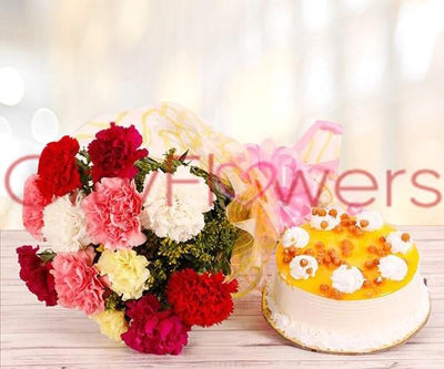 ASSORTED CARNATIONS WITH BUTTERSCOTCH CAKE flowers CityFlowersIndia