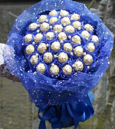 Ferrero Rocher Bouquet With Blue paper Packing flowers CityFlowersIndia