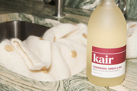 Kair Wool, Silk & Delicates Wash by Marble Sink with Cream & Gold Sweater