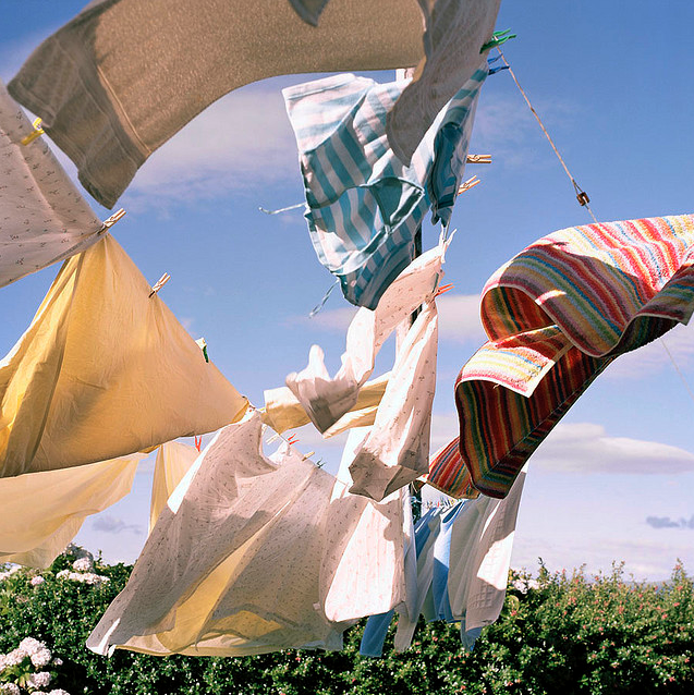 Colourful laundry on a washing line with countryside background
