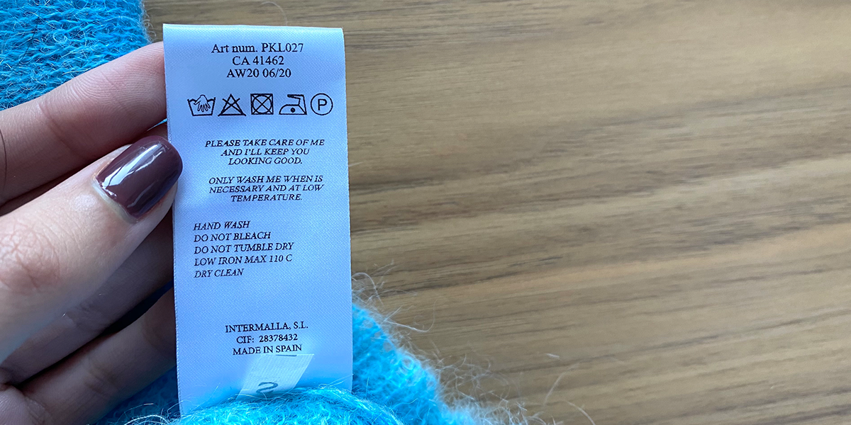 Close up of washing label showing 'hand wash only' sign