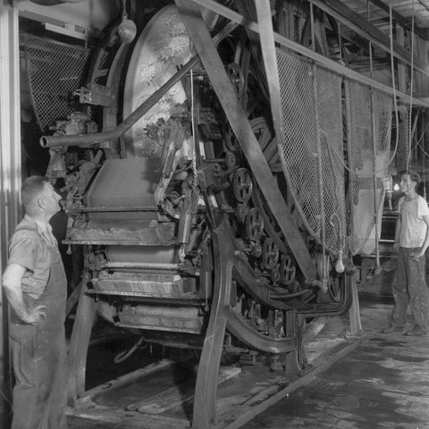A timeless image of two hard working York employees working the oldest surface print machine in the United States.