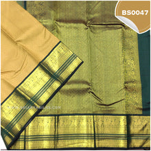 Load image into Gallery viewer, Dark Beige Self Embossed Saree With Bottle Green Border 2