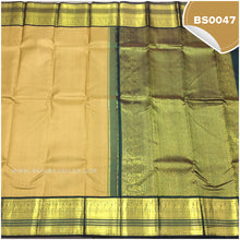 Load image into Gallery viewer, Dark Beige Self Embossed Saree With Bottle Green Border 3