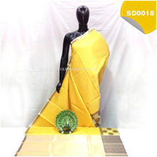 Load image into Gallery viewer, Light yellow kora organza saree with copper peacock buttas