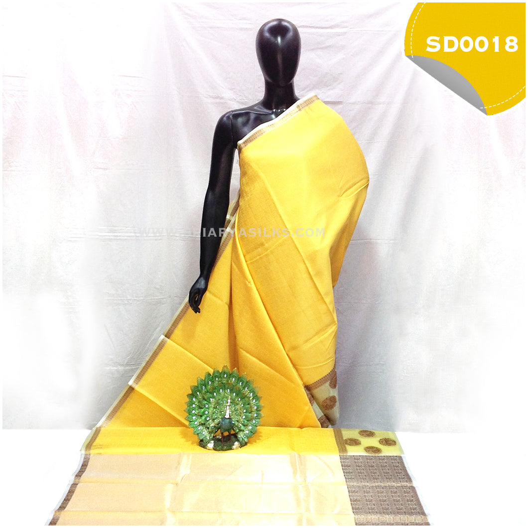Light yellow kora organza saree with copper peacock buttas